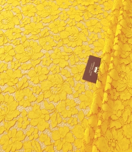 Yellow guipure lace fabric