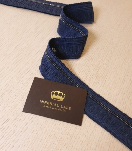Blue thread ribbon with metal details application