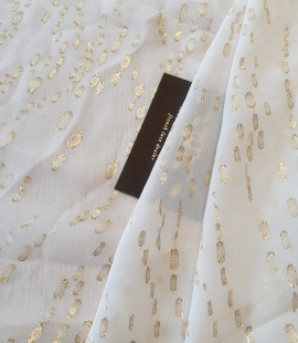 Ivory with gold dots ...