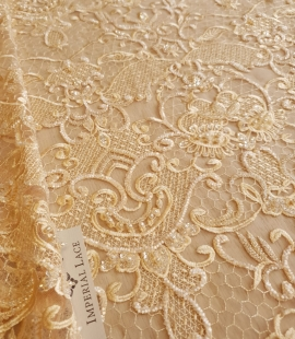 Yellow beaded lace fabric