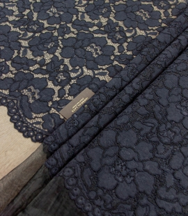 Dark blue floral guipure lace on black organza fabric