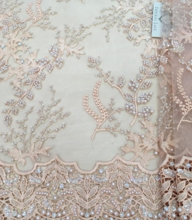 Peach beaded lace fabric