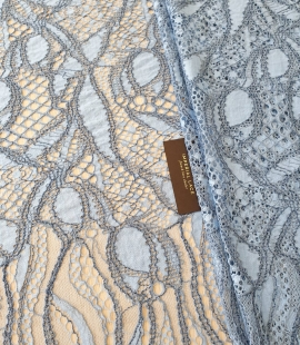 Light and dark blue chantilly lace fabric