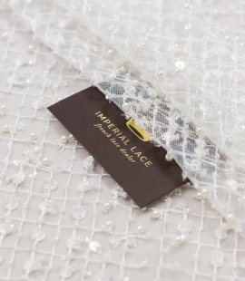 Off white beaded mesh pattern on tulle fabric