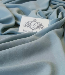 Greenish grey silk crepe fabric