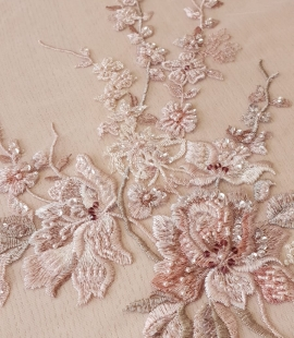 Pink beaded floral lace fabric
