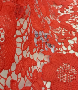 Coral orange macrame lace fabric