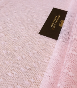 Light pink dotted tulle fabric