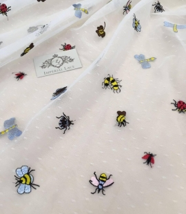 Offwhite tulle fabric with multicolor bees