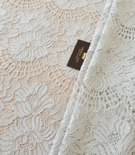 Light grey with bluish green guipure lace fabric