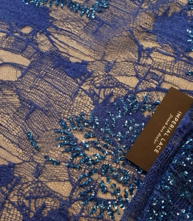Blue beaded lace fabric