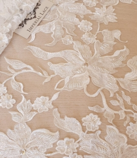 Ivory beaded floral pattern embroidery on tulle fabric