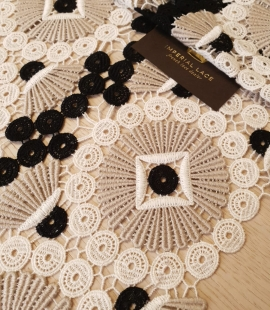 Beige with black and white macrame lace fabric