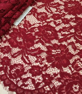 Darker red guipure lace fabric