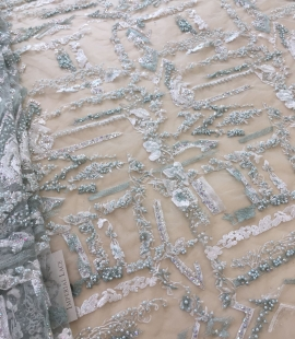 Mint green beaded embroidery on tulle fabric
