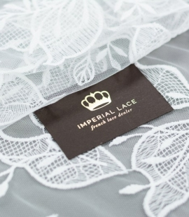 Ivory leaves pattern embroidery on tulle fabric