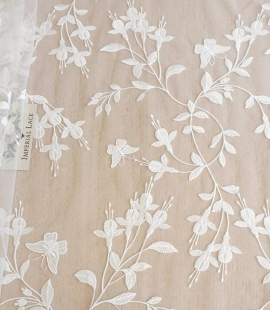 Ivory embroidery on tulle lace fabric