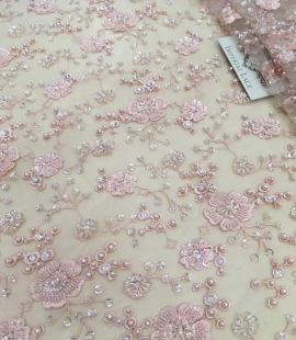 Light pink beaded lace fabric
