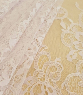 White with lilac shade chantilly lace fabric