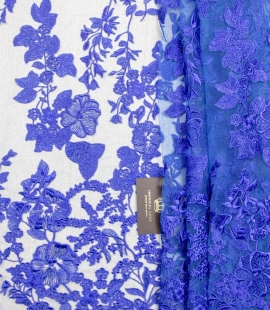 Vibrant blue embroidery on blue tulle fabric