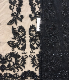 Black beaded embroidery on tulle fabric