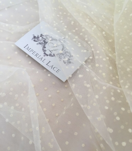Creme color tulle fabric with dots
