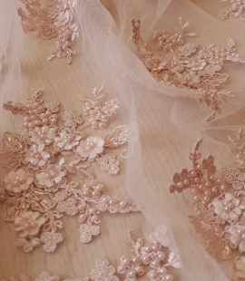 Powder pink beaded lace fabric