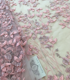 Pink beaded lace fabric