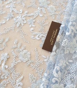 Light blue beaded lace fabric