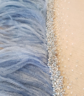 Light blue ostrich feather with beads on tulle fabric