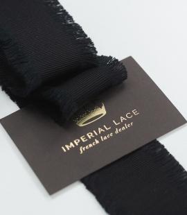 Black ribbon with fringes on both sides