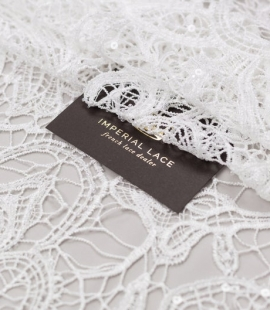 Off white acrame beaded floral lace fabric.