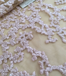 Pink embroidery on nude tulle lace fabric