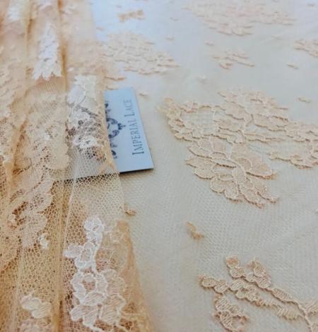 Rusty yellow lace fabric. Photo 6
