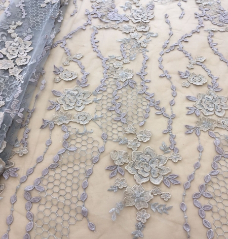 Greyish blue embroidery on tulle fabric. Photo 1