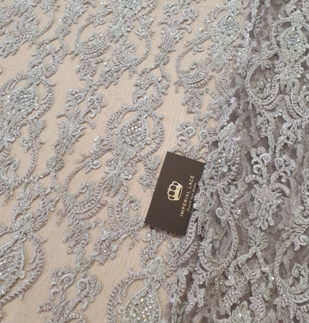 Lilac grey beaded lace fabric. Photo 1