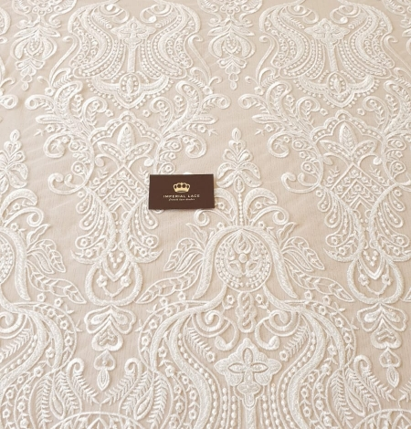 Ivory embroidery on tulle lace fabric. Photo 4
