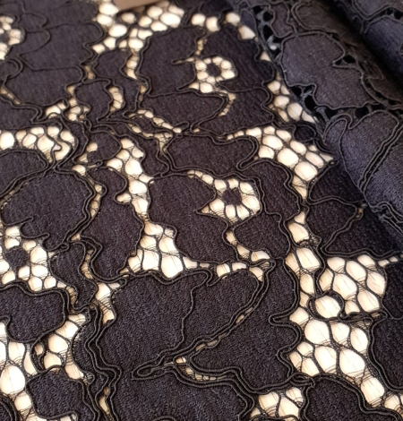 Black guipure lace fabric. Photo 2