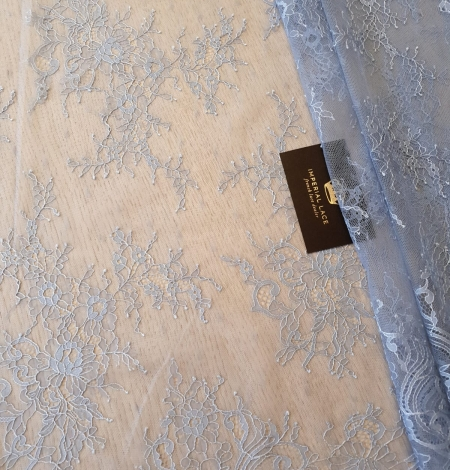 light blue floral pattern chantilly lace fabric. Photo 1