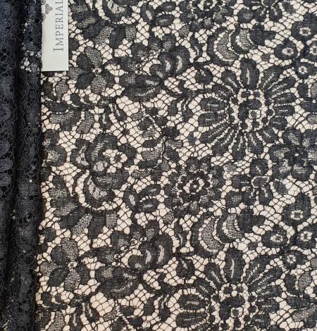 Black viscose chantilly lace fabric. Photo 1