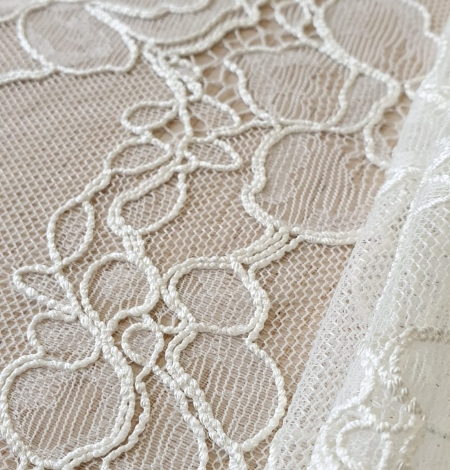 Ivory chantilly lace with thick thread lace fabric . Photo 5