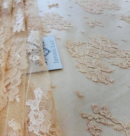 Rusty yellow lace fabric. Photo 1