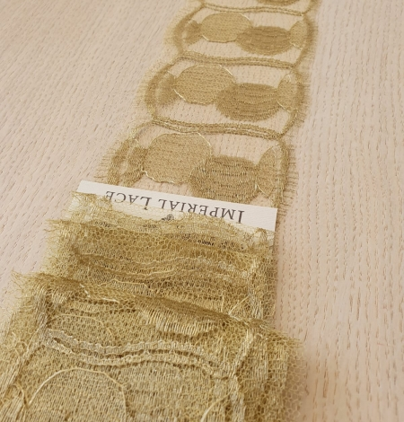 Gold chantilly lace fabric. Photo 2