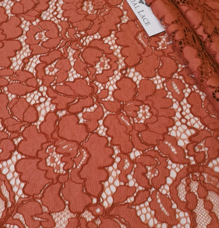 Redish brown guipure lace fabric. Photo 1