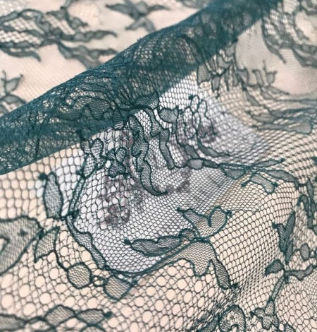 Deep teal green lace fabric. Photo 4