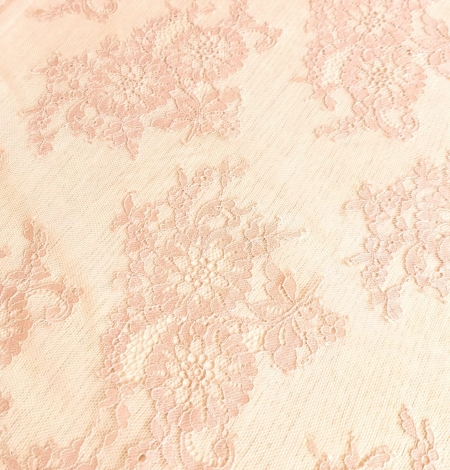 Powder color Chantilly lace fabric . Photo 2