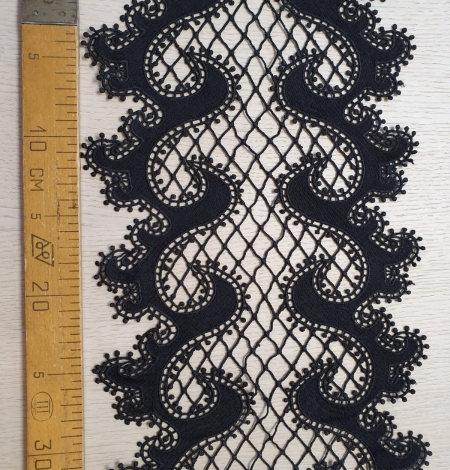 Black 100% polyester wave effect guipure lace trimming. Photo 7