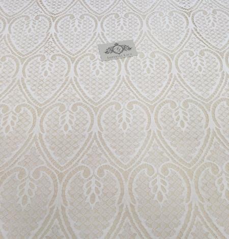 Ivory figurative lace fabric . Photo 2