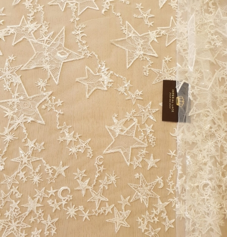 Ivory 100% polyester star pattern embroidery on tulle with beads and chantilly details lace fabric. Photo 7