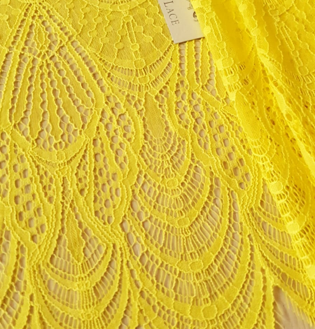 Yellow lace fabric. Photo 1